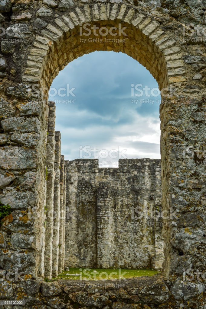 A window of an early Christian basilica in the city of Omišalj, the island of Krk, Croatia stock photo