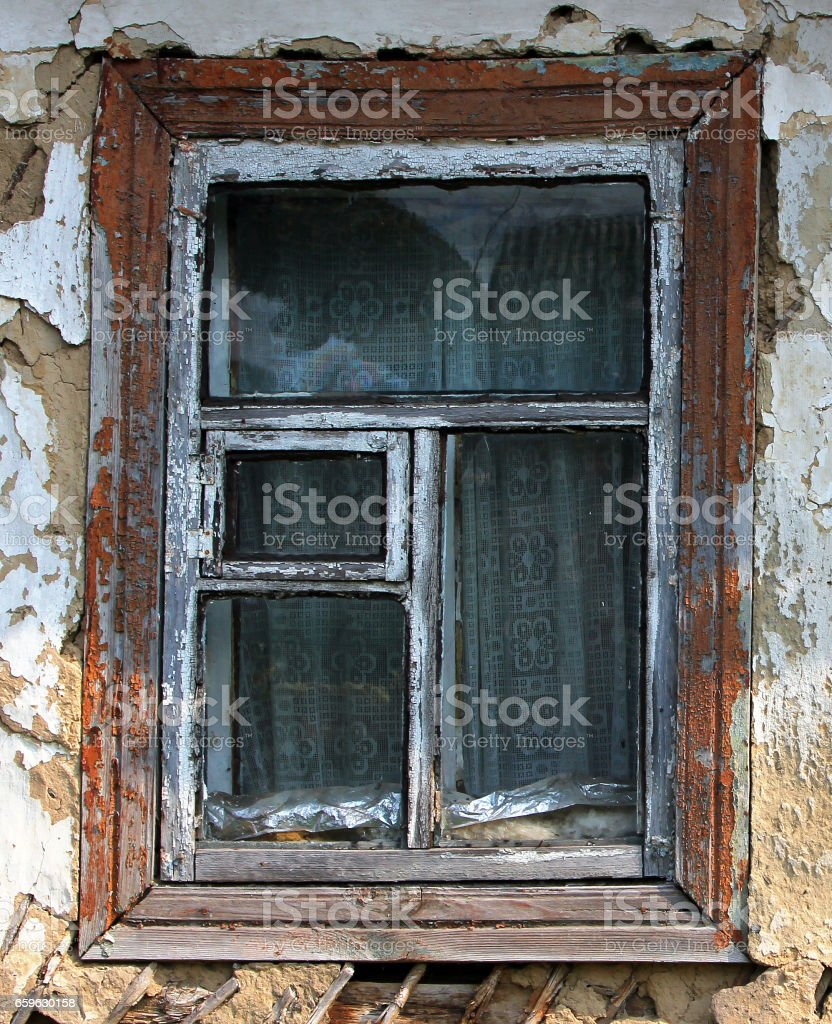 Window of an old abandoned farmhouse stock photo