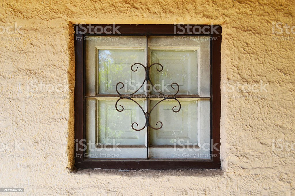 Window of an old adobe cellar stock photo
