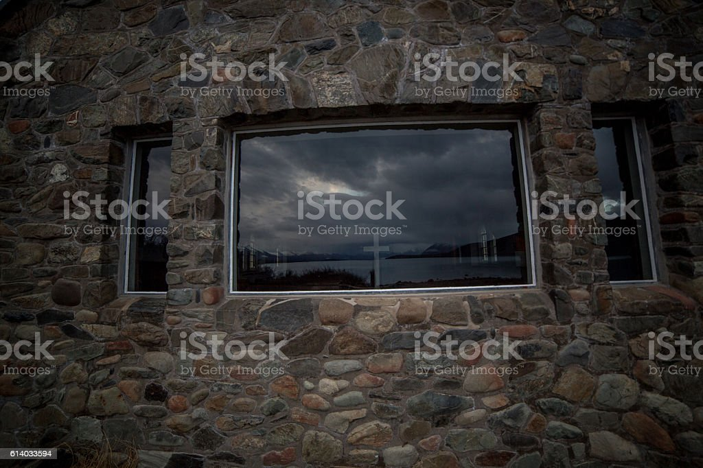 Window of the Church of the Good Shepherd and reflections stock photo