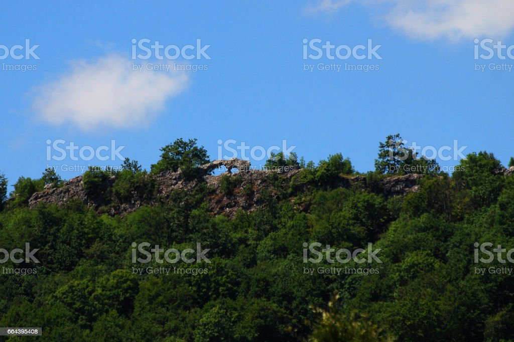 Window on cliff with a blue dynamic sky stock photo