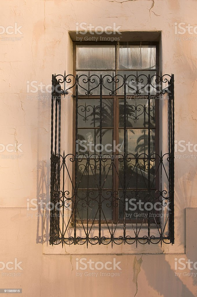 Window on Pink Wall, Security Bars, Crime Prevention, Warm Tone stock photo