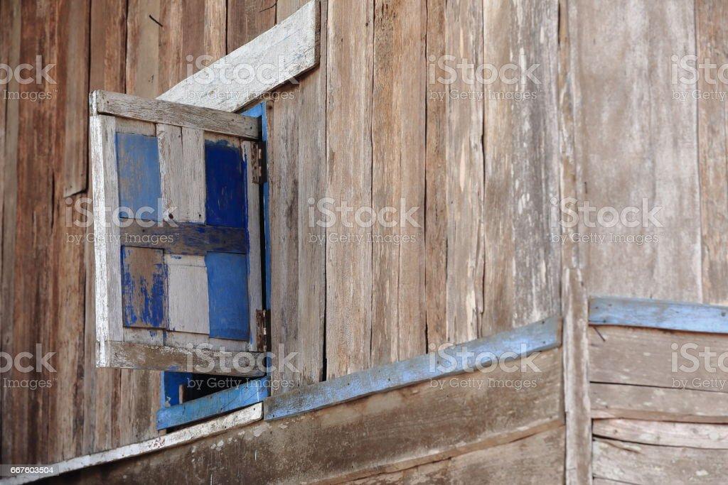 Window on wooden wall-Lu tribe. SopChem village-Luang Prabang province-Laos. 3962 stock photo