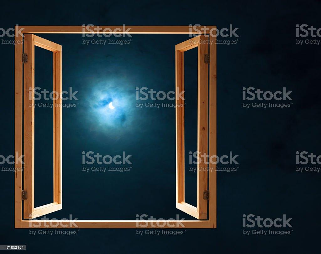 window open dark night half moon light view stock photo