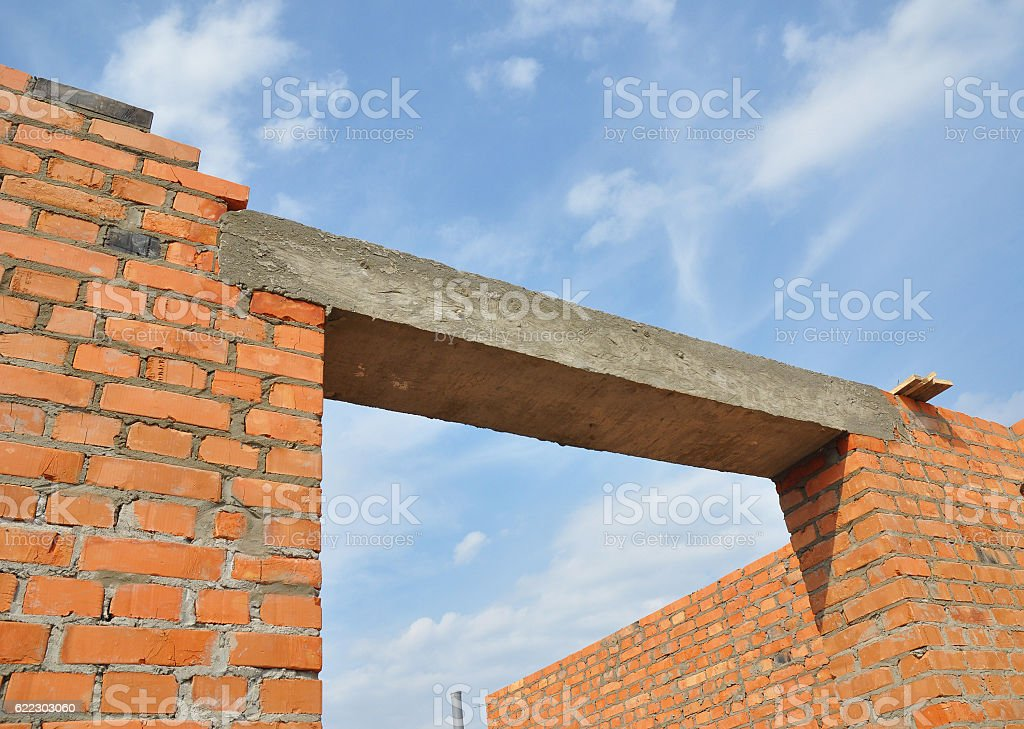 Window or door concrete lintel on brick unfinished house construction. stock photo