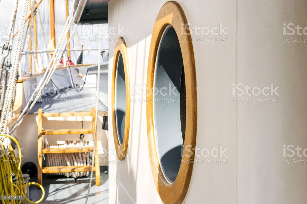 Window or porthole on a tall ship stock photo