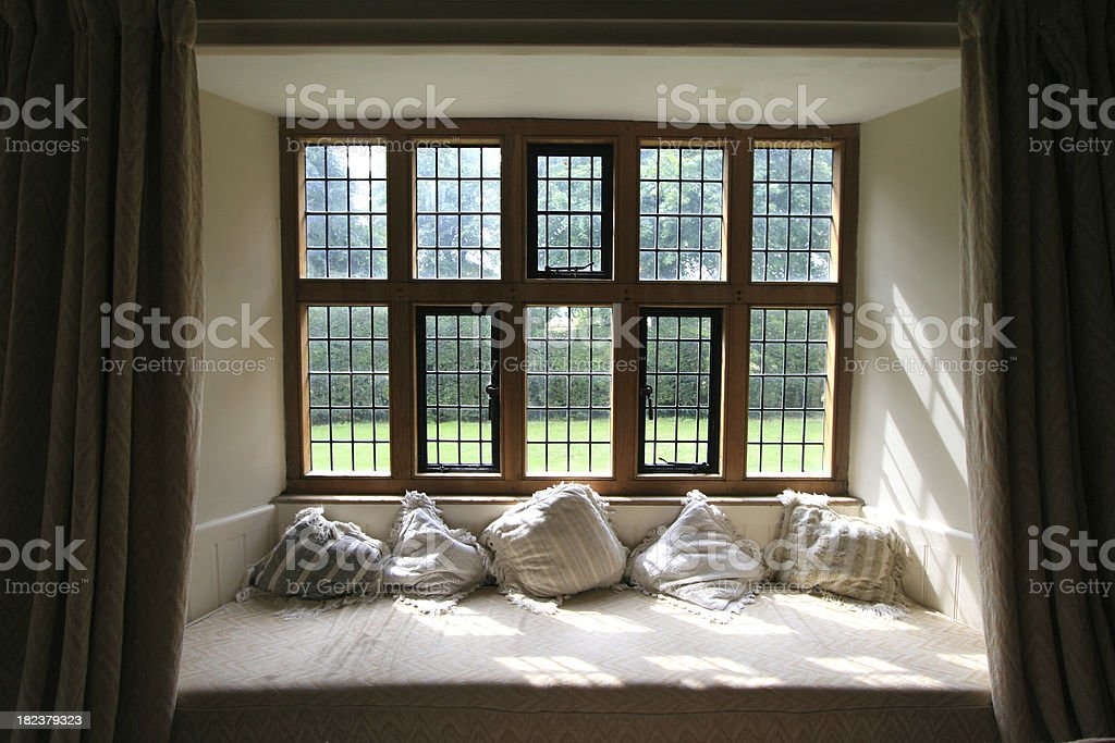 Window seat in an Elizabethan country House, England, UK royalty-free stock photo