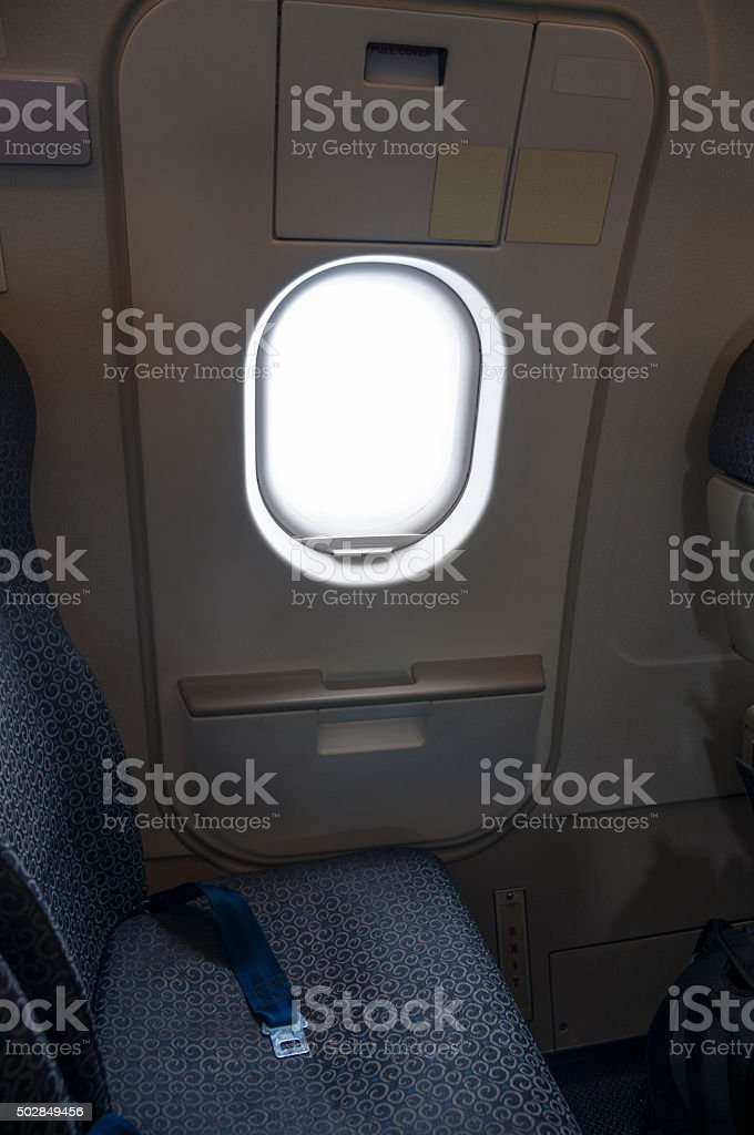 Window Seat Next To The Emergency Exit Inside An Airplane stock photo