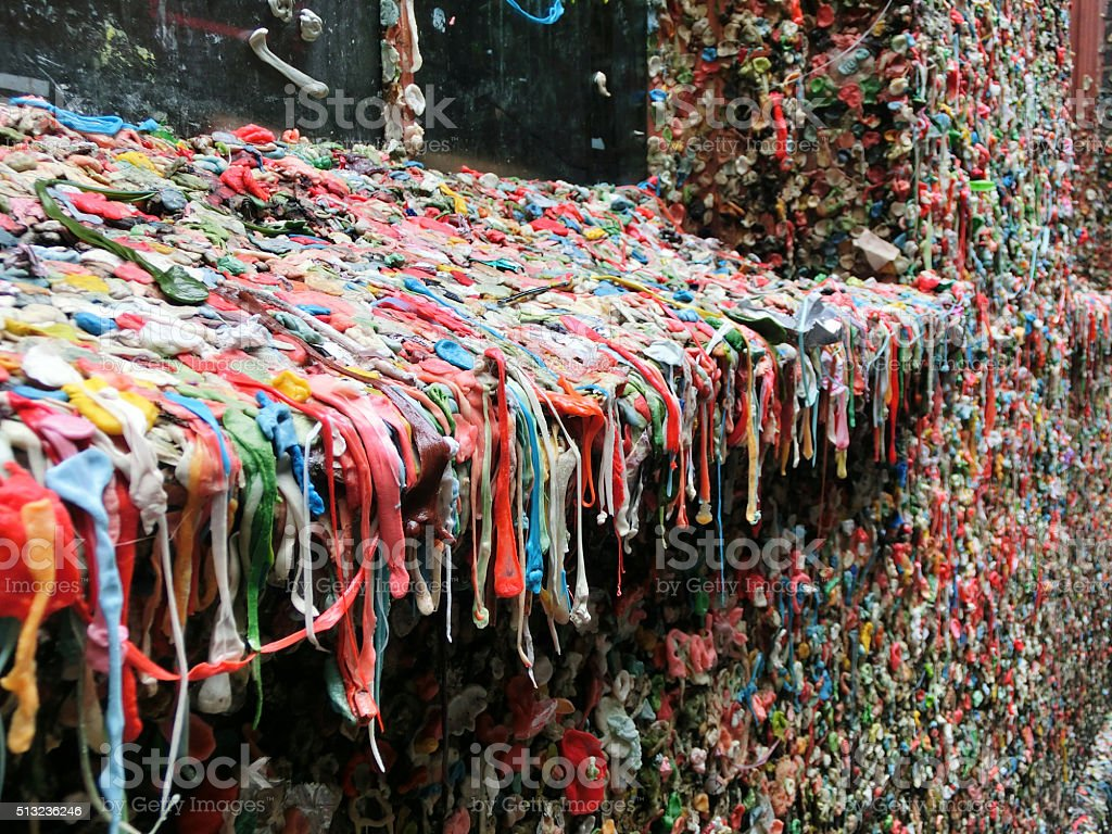 Window sill covered in used chewing gum in Seattle stock photo