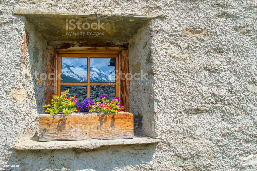 Window typical of the Swiss Alps stock photo