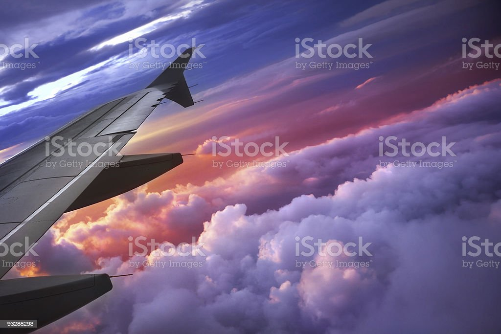 A window view of an aircraft with the wing tip and the sky stock photo