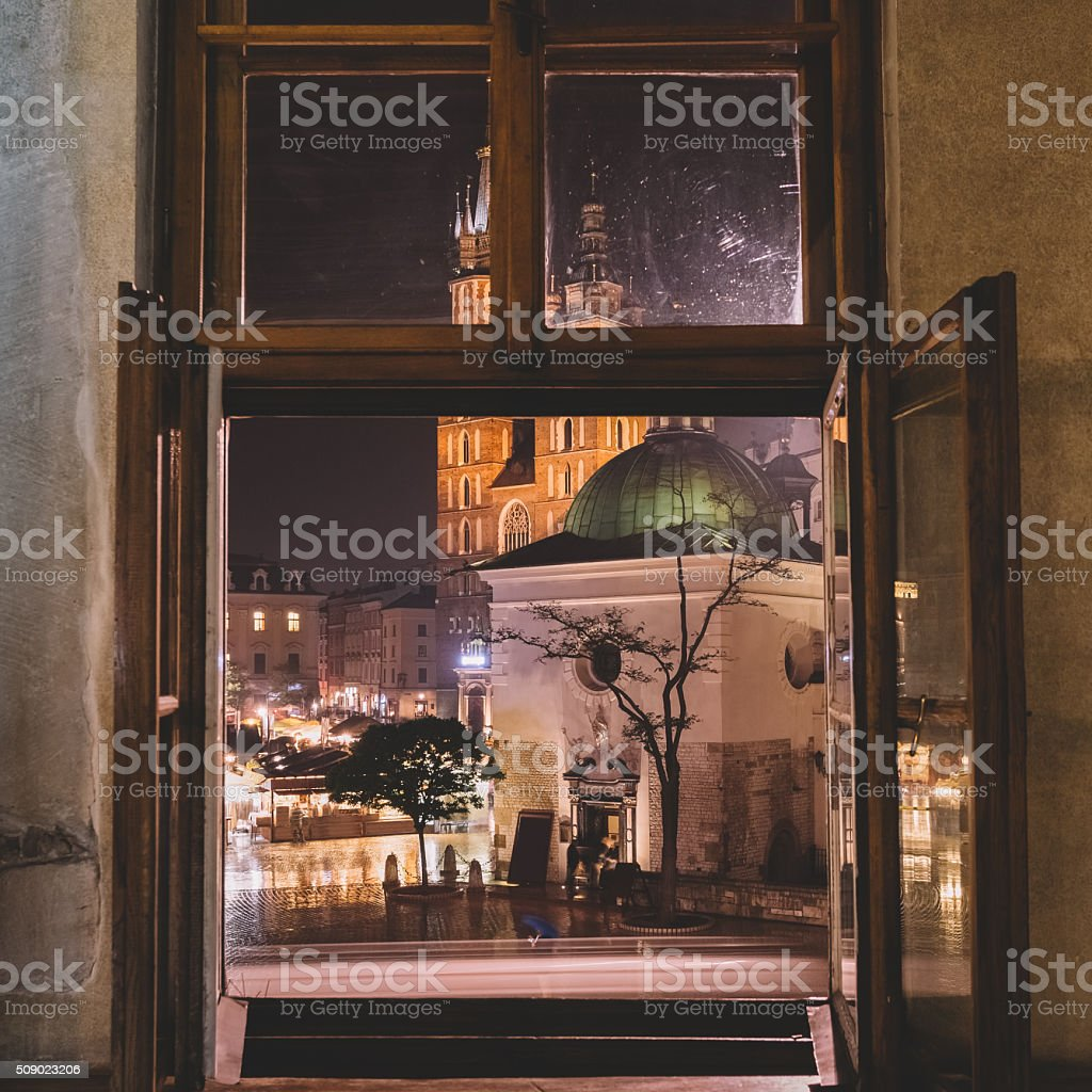 Window view of the Main Market square of Krakow stock photo