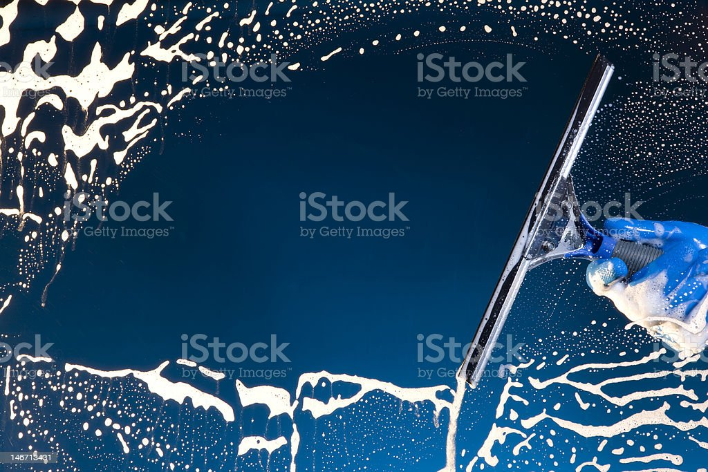 Window washer cleaning glass stock photo