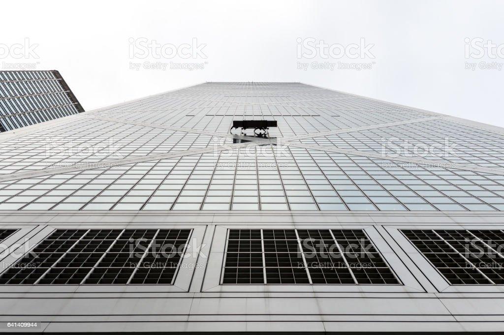 Window washers work on a tall skyscraper stock photo