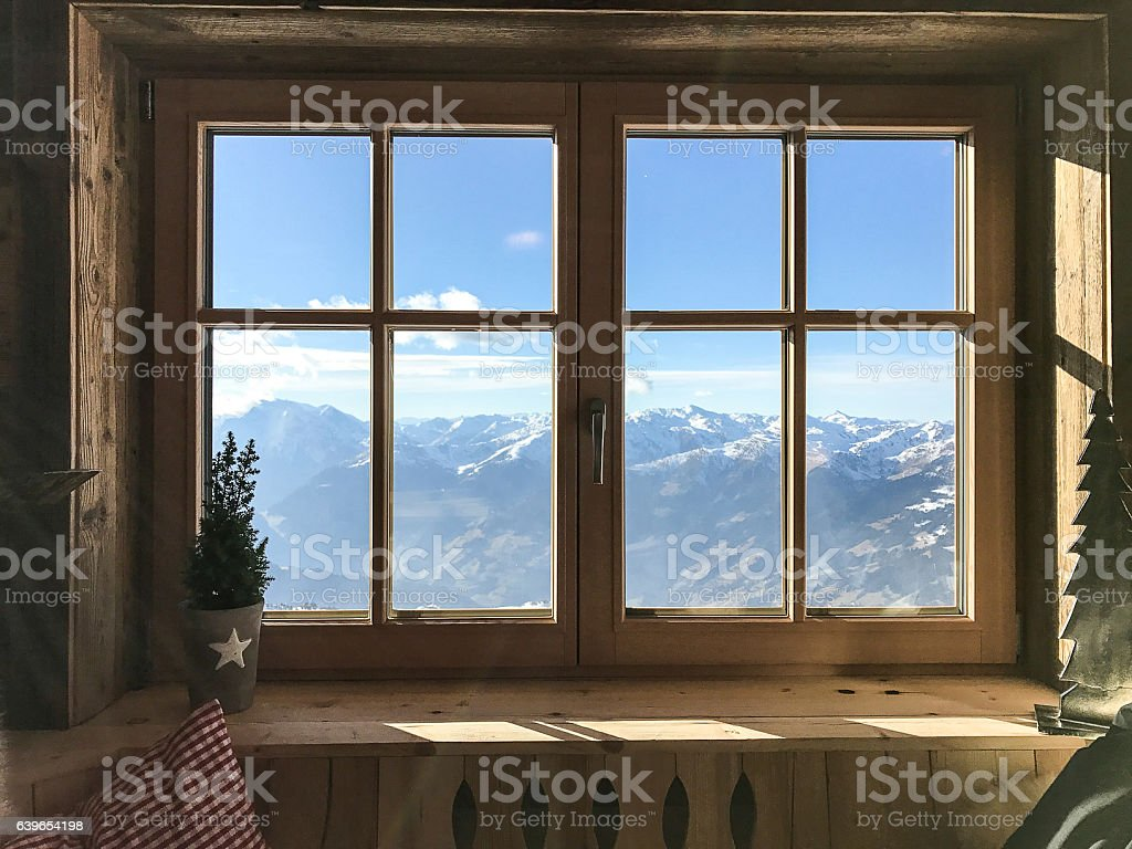 window with alps in background stock photo
