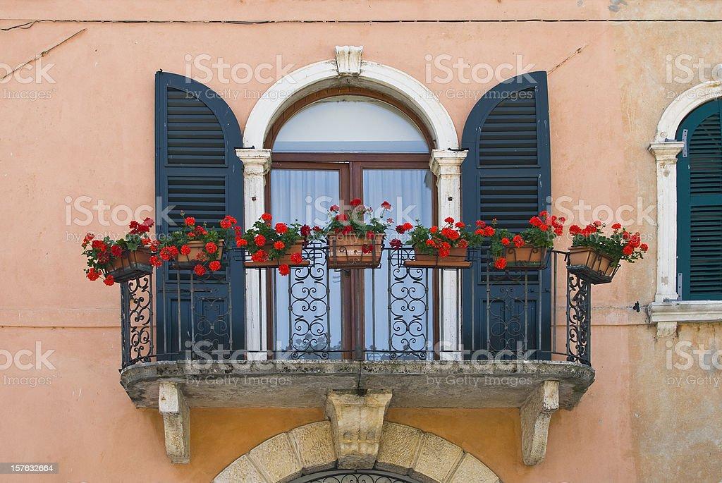 Window with balcony in Italy stock photo