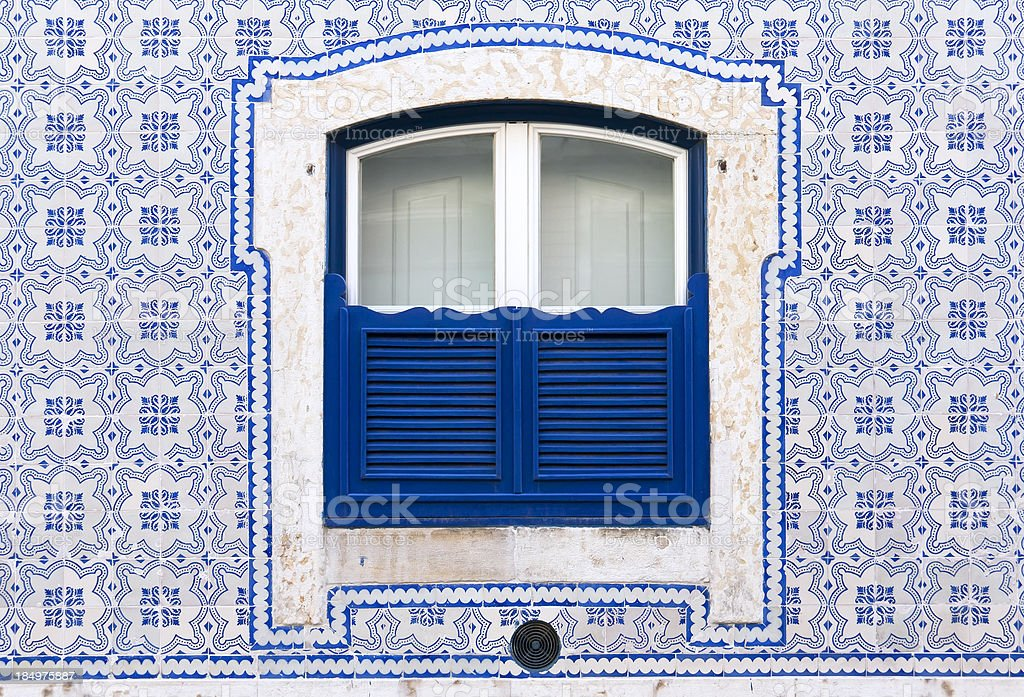 Window with beautiful blue tiles royalty-free stock photo