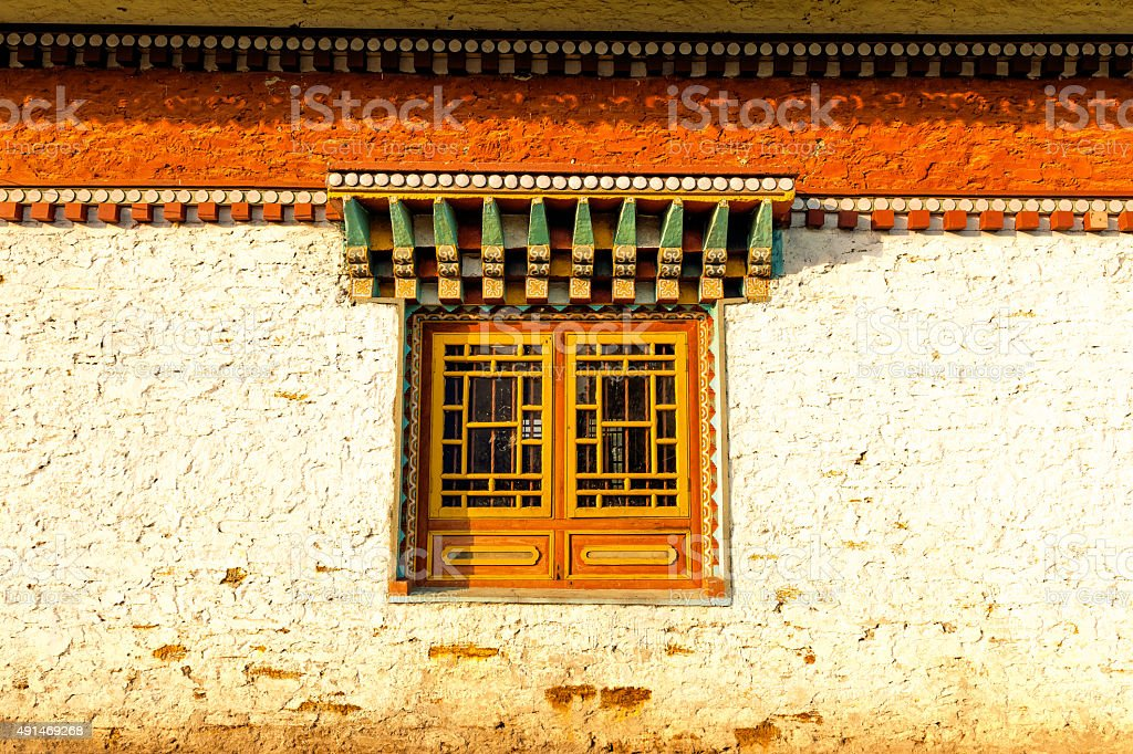 Window with Buddhist in Sikkim,Tibet, India stock photo