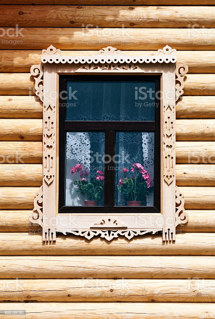 Window with carved architraves stock photo