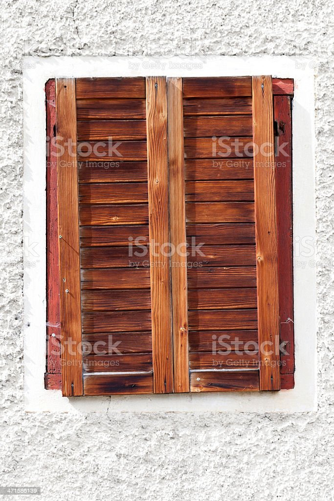 Window with closed wooden shutters royalty-free stock photo