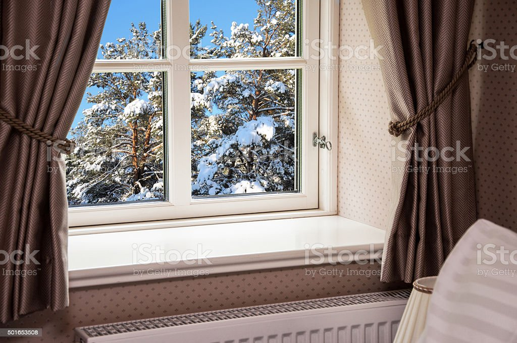 Window with curtains in winter stock photo