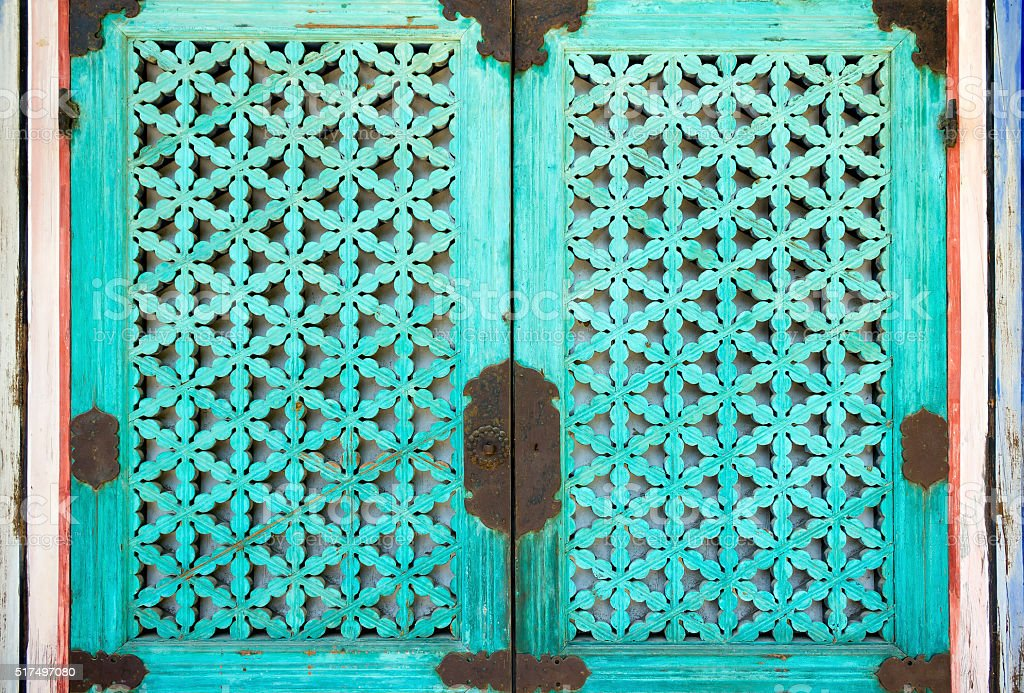 Window with decorative turquois shutter stock photo
