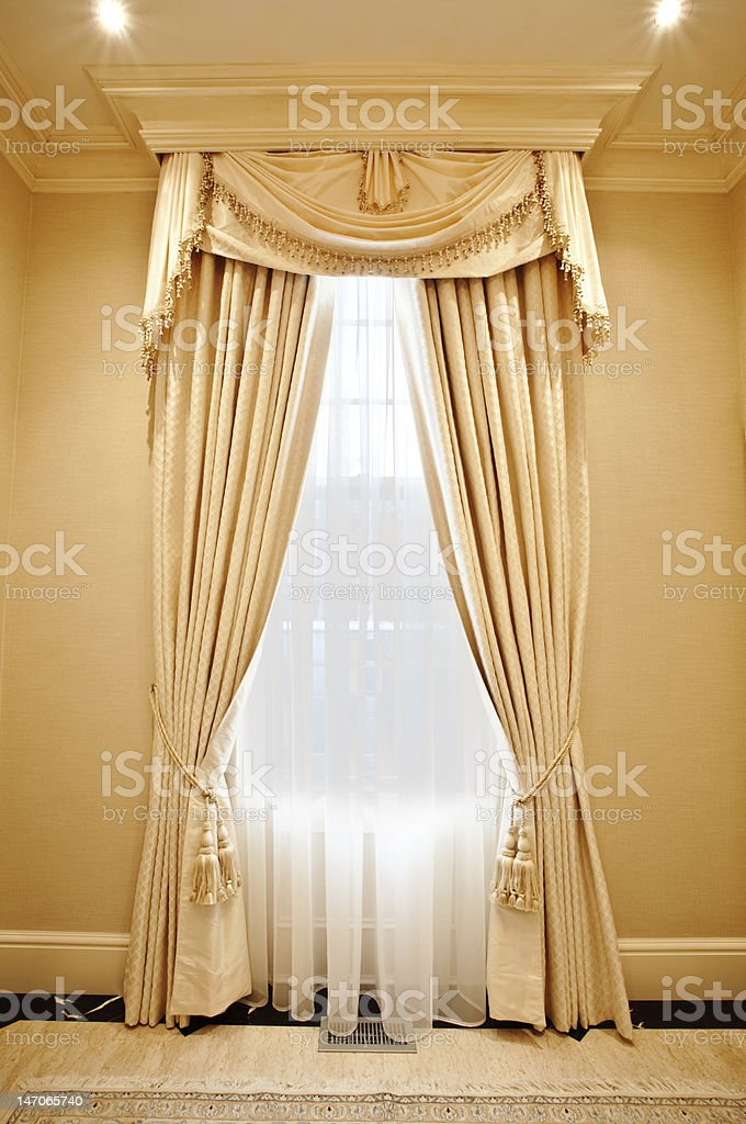 Window with elegant drapery decoration royalty-free stock photo