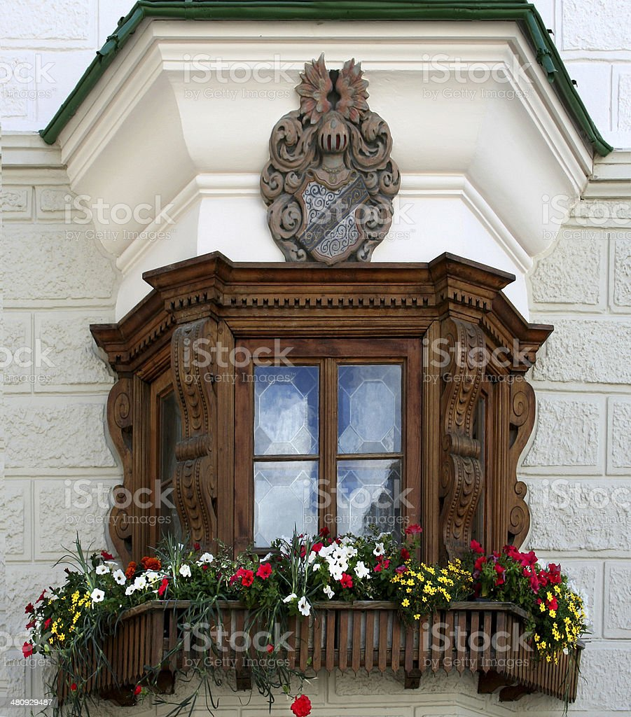 Window with flower boxes stock photo