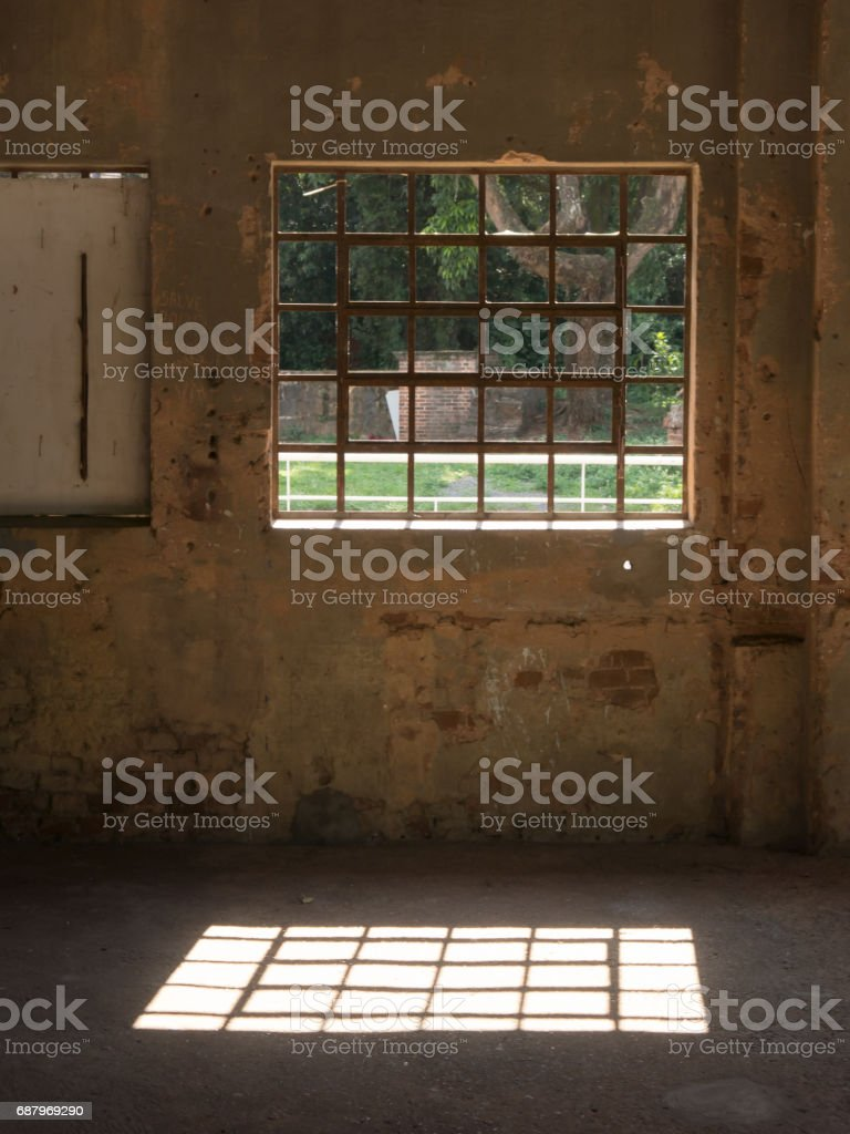 Window with iron bars in old wall stock photo