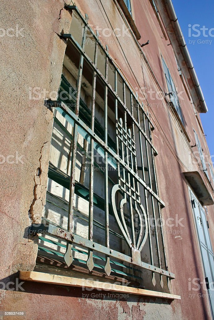 Window with iron grating royalty-free stock photo