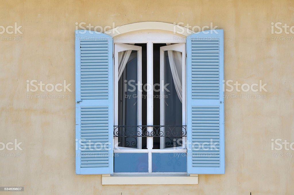 Window with louvre doors stock photo