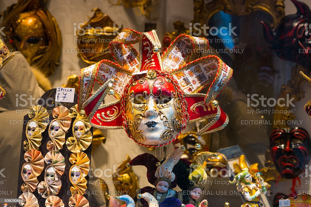 Window with masks and souvenirs from the Venetian Carnival stock photo