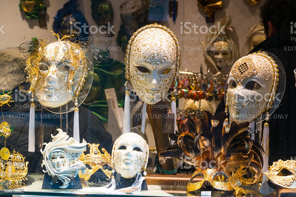 Window with masks from the Venetian Carnival stock photo