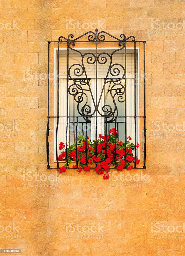 Window with metal winding grid stock photo