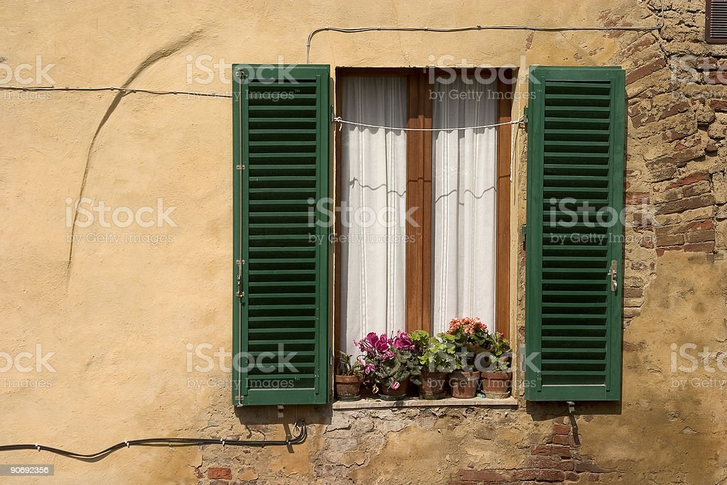 Window with Open Green Shutters stock photo