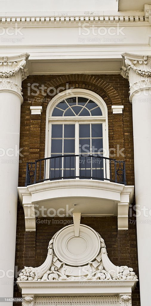 Window with Ornate Balcony - Federal Revival stock photo