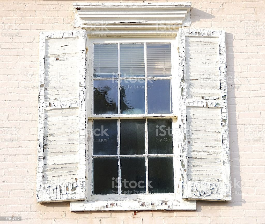Window with Peeling Paint Shutters royalty-free stock photo