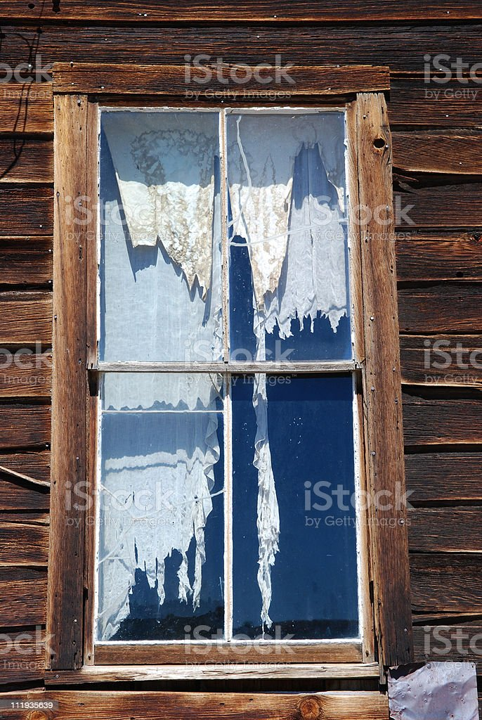Window with Ragged Curtains royalty-free stock photo