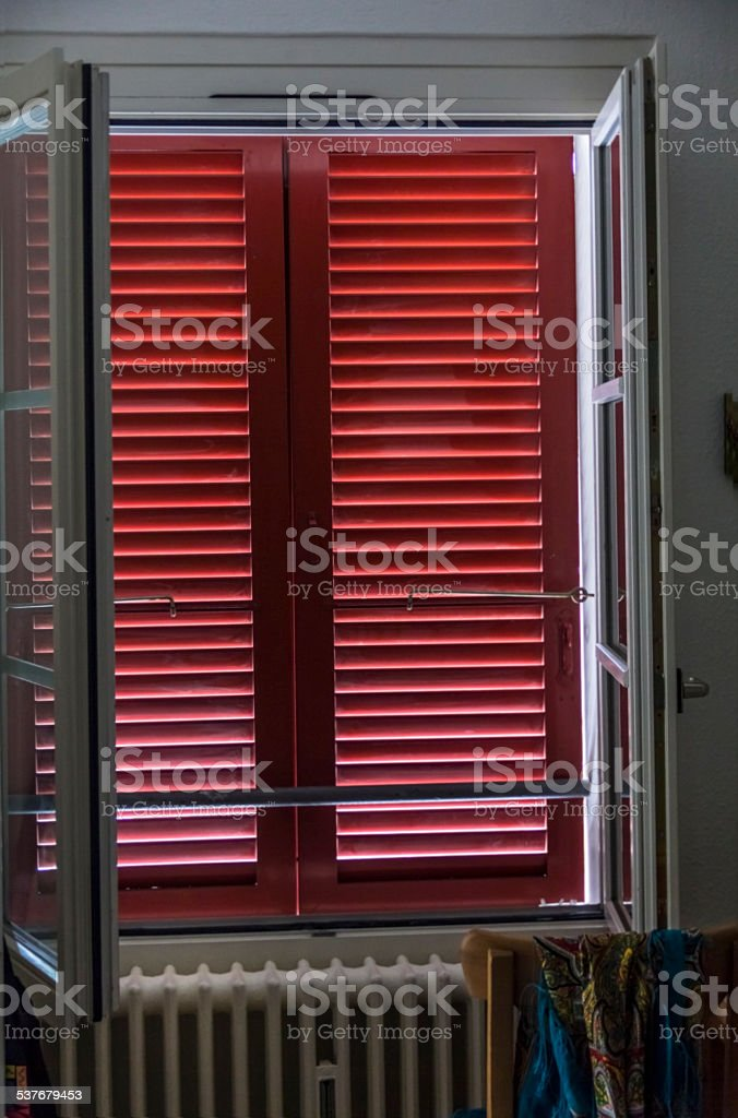 Window with shutters inside stock photo
