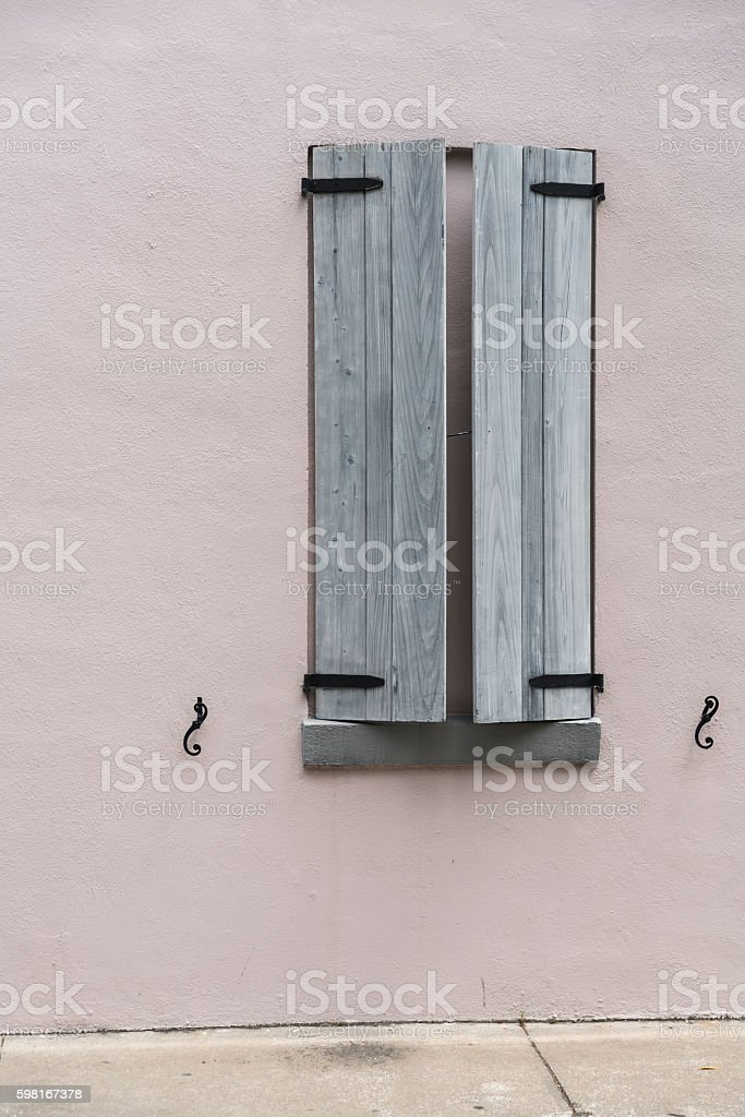 Window with wooden sun blinds stock photo