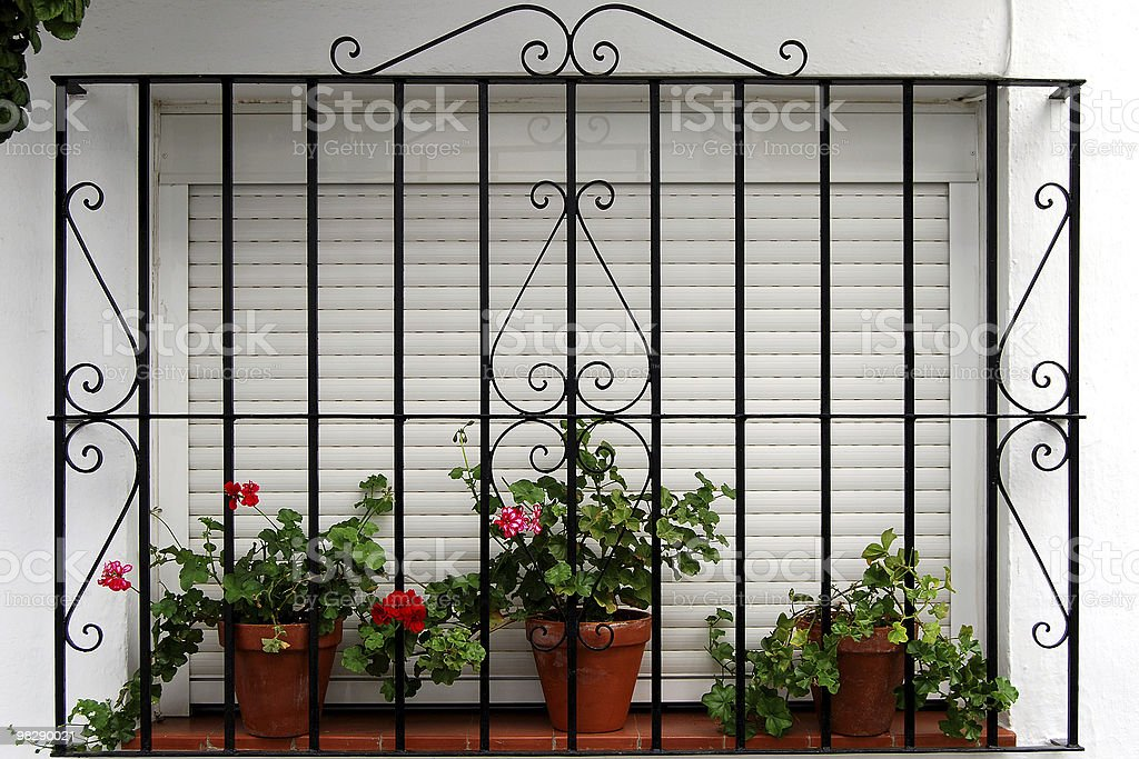 Window with wrought iron grille in Spain stock photo