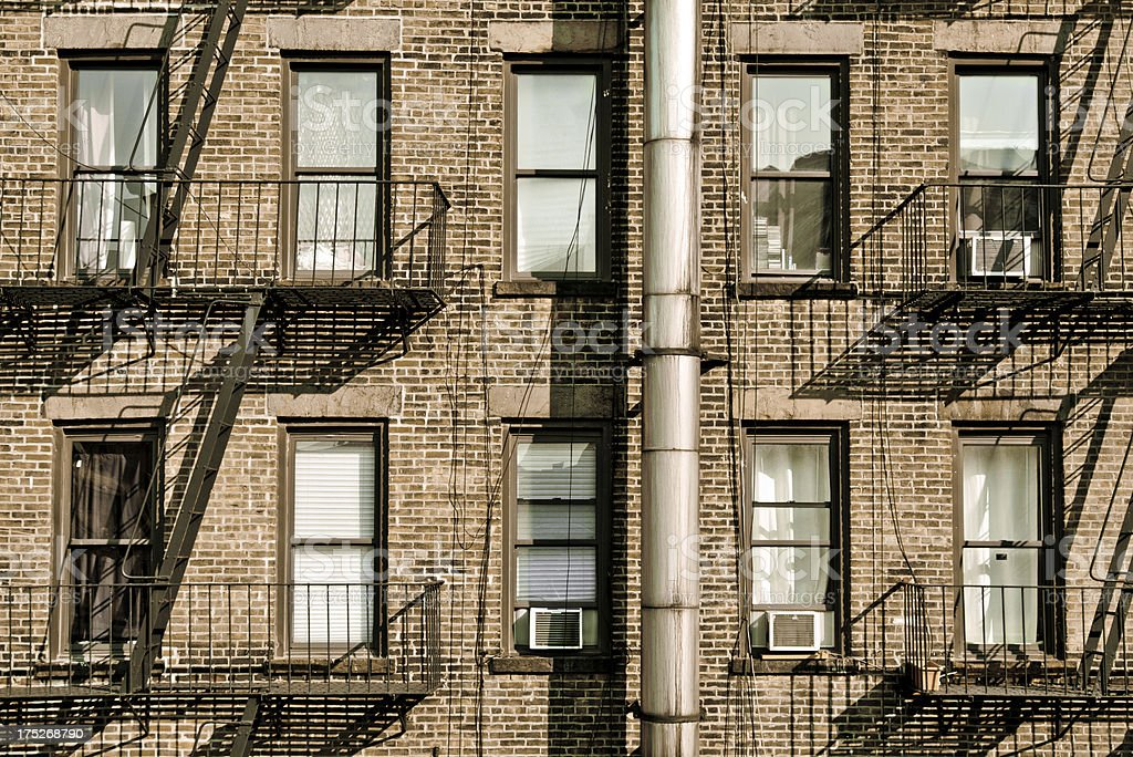 Windows Along Side Of Brick Building In New York City Stock Photo