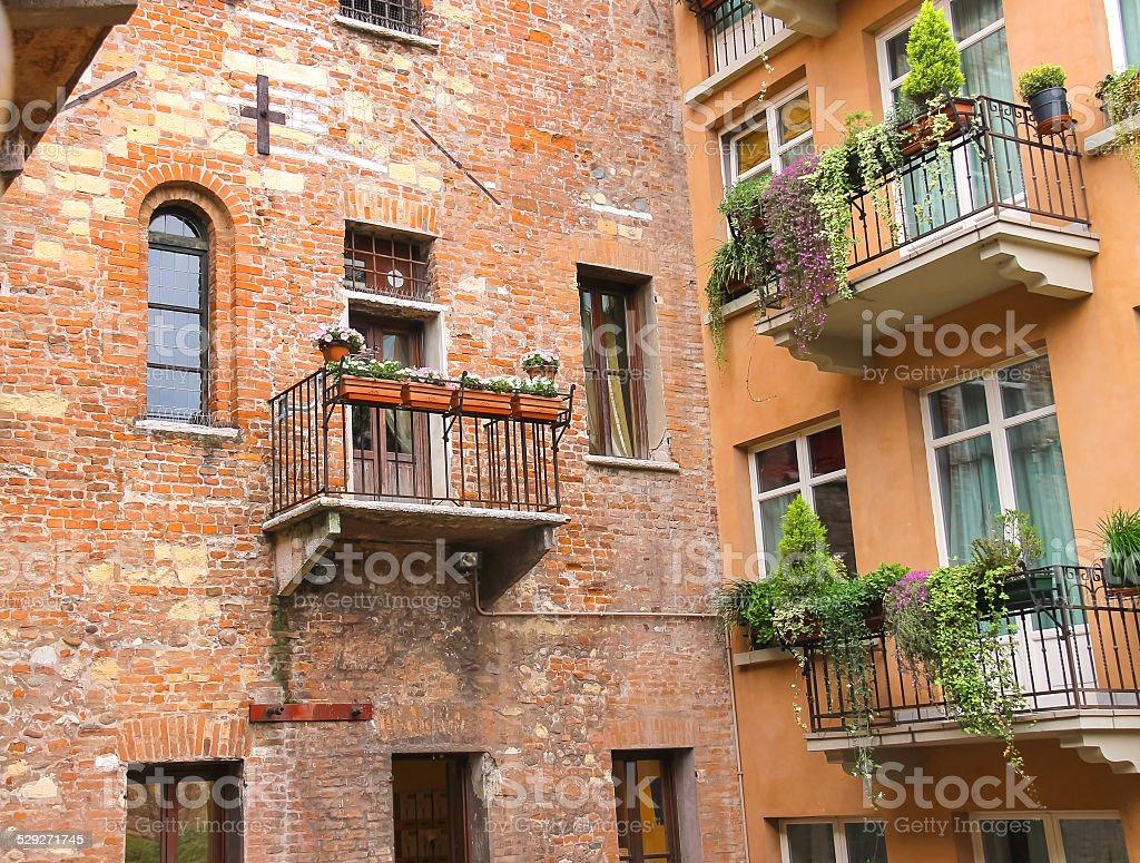 Windows and balconies in the  courtyard . Verona, Italy stock photo