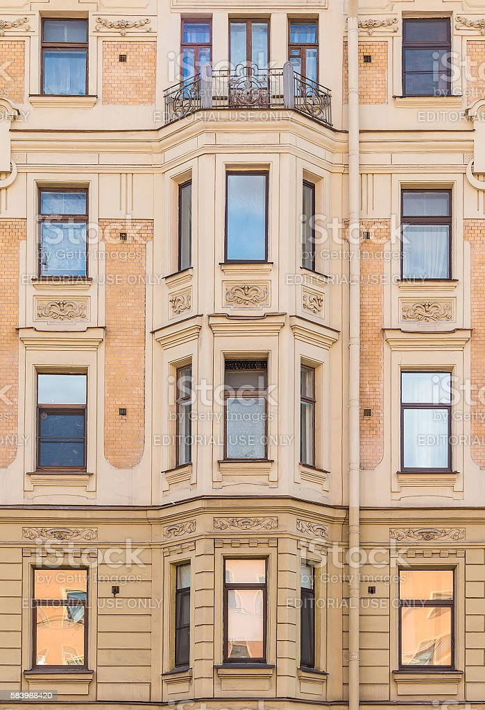Windows and bay window on facade of apartment building stock photo