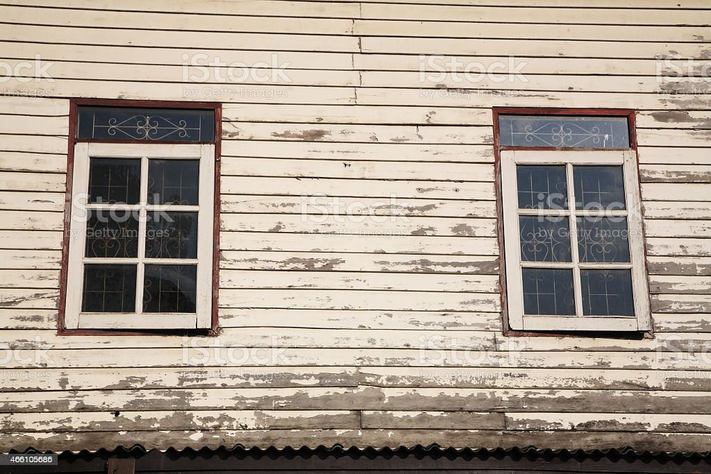 Windows and old wooden wall of cottage stock photo