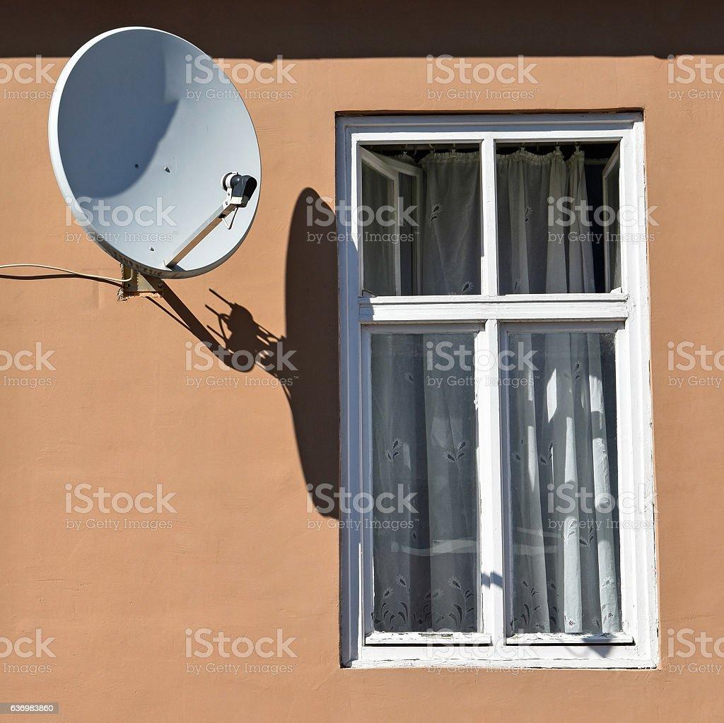 Windows and satellite dish stock photo
