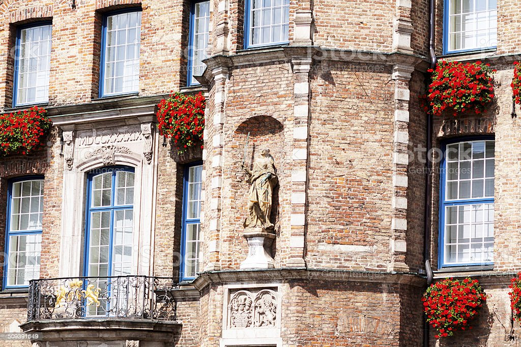 Windows and statue of Justitia stock photo