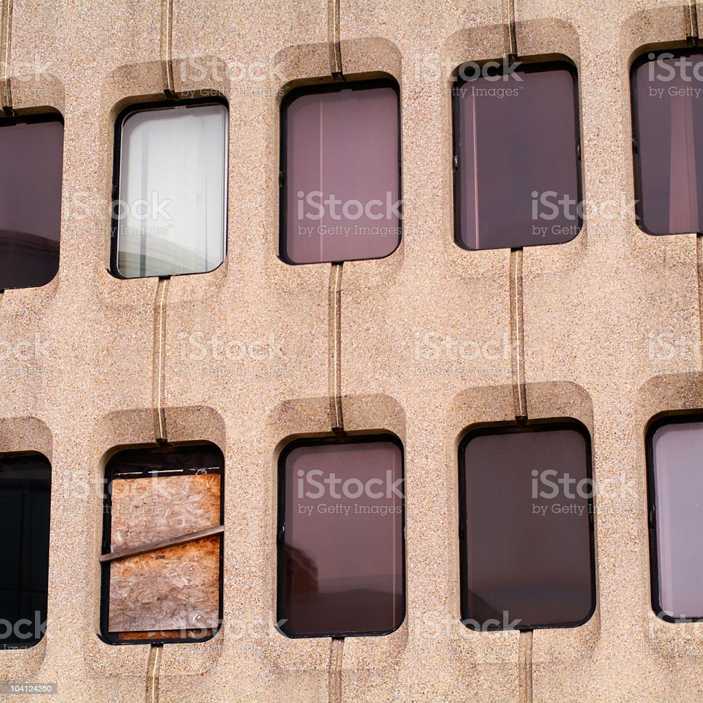 Windows assortment! One is boarded up stock photo