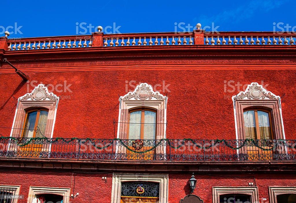Windows Balcony Red Wall San Miguel de Allende Mexico stock photo