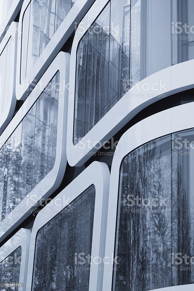Windows facade of modern office building vertical format royalty-free stock photo